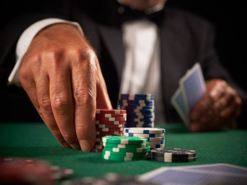 A VIP card player gambling casino chips in a stock photo. Image: iStock/Getty Images