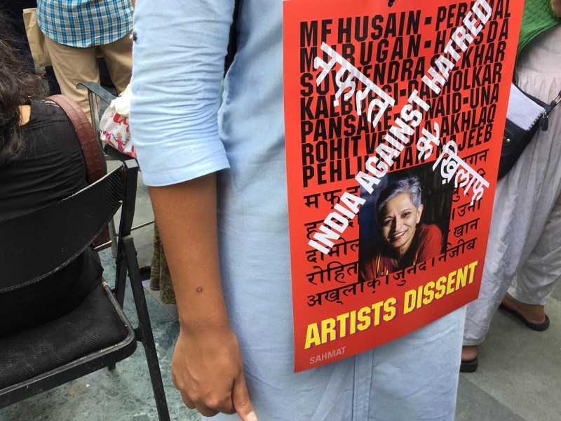 A demonstrator wears a poster with the photograph of Gauri Lankesh, the Indian journalist murdered in Bangalore on Sept. 5, 2017, along with names of other recent victims of persecution in India. Photo: Asia Times/Patrick Dunne