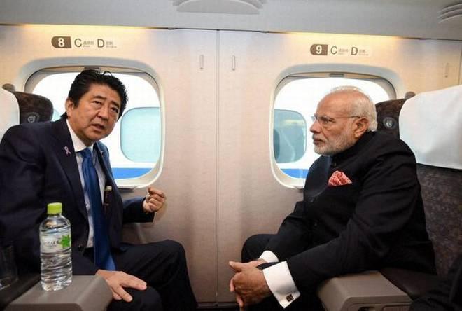 Japanese Prime Minister Shinzo Abe and Indian PM Narendra Modi on the Shinkansen bullet train in Japan. File photo: The Hindu
