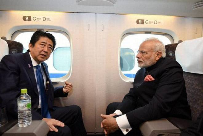 Japanese Prime Minister Shinzo Abe and Indian PM Narendra Modi on the Shinkansen bullet train in Japan. File photo: The Hindu