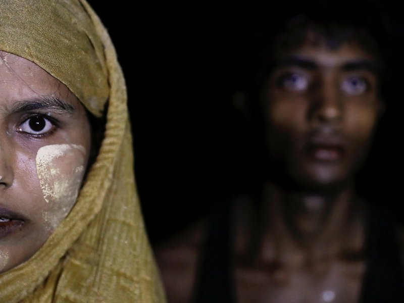 A woman makes her way to the shore as hundreds of Rohingya refugees arrive under the cover of darkness by wooden boats from Myanmar to Shah Porir Dwip, in Teknaf, near Cox's Bazar in Bangladesh, September 27, 2017. Photo: Reuters/Damir Sagolj