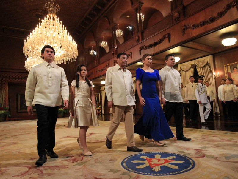 Philippines President Rodrigo Duterte (C) walking with his children Sebastian (L), Veronica (2nd L), Sara (2nd R) and Paolo (R) after an oath-taking ceremony at the Malacanang Palace in Manila. Photo: AFP/Stringer/Presidential Communications Office/ Stringer