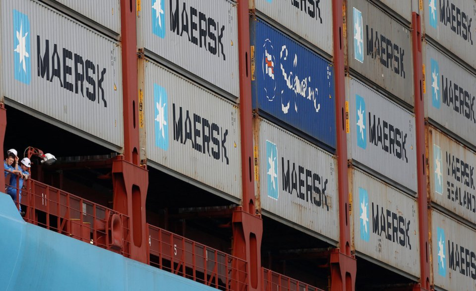 FILE PHOTO - Crew members look out from the world's largest container ship, the MV Maersk Mc-Kinney Moller, as it berths during its maiden port of call at a PSA International port terminal in Singapore September 27, 2013. REUTERS/Edgar Su/File Photo