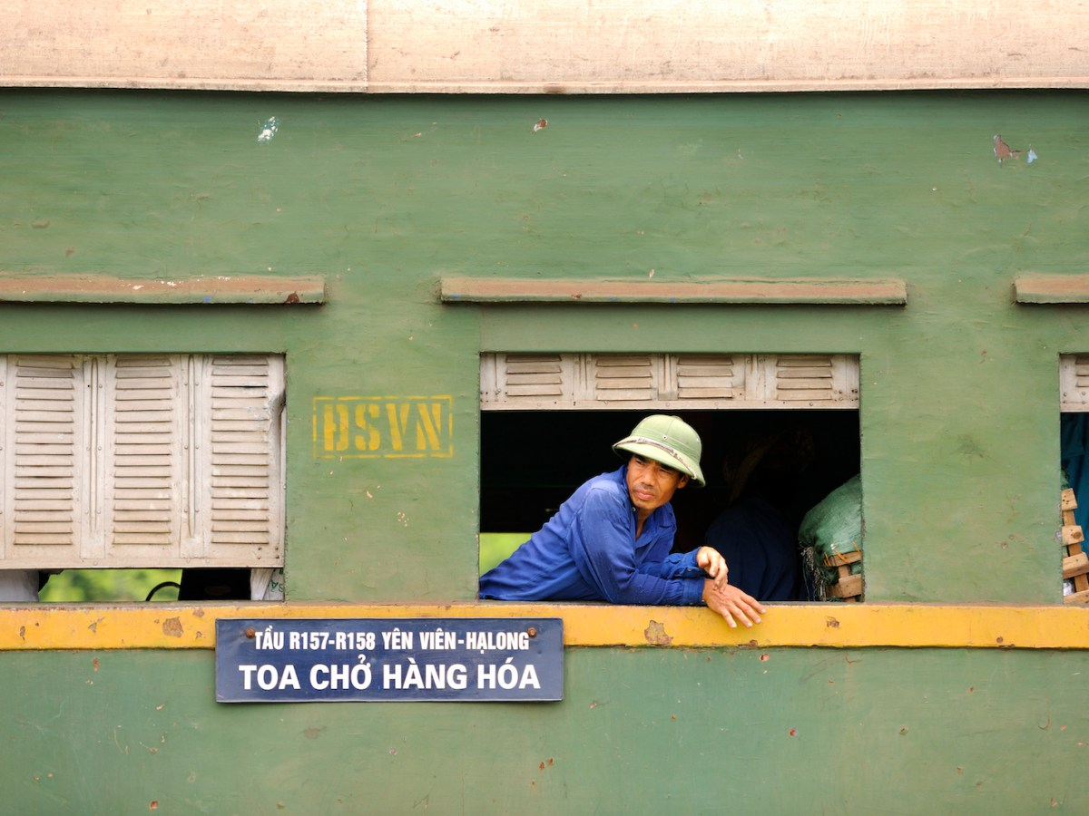 A Vietnamese passenger rides an old train reserved for traders and their goods between Hanoi and Along. Photo: AFP