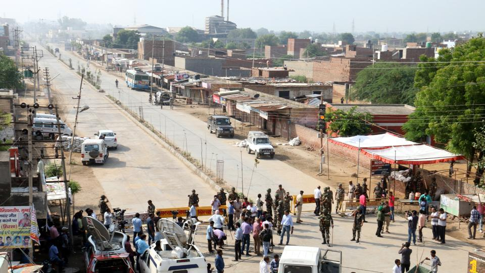A road leading to one of two Dera Sacha Sauda sites is blocked by police on Friday. Photo: Hindustan Times