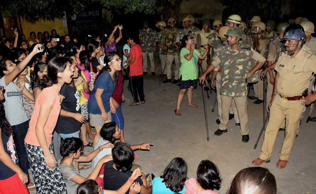 Police confront protesters at Banaras Hindu University. Photo: NDTV