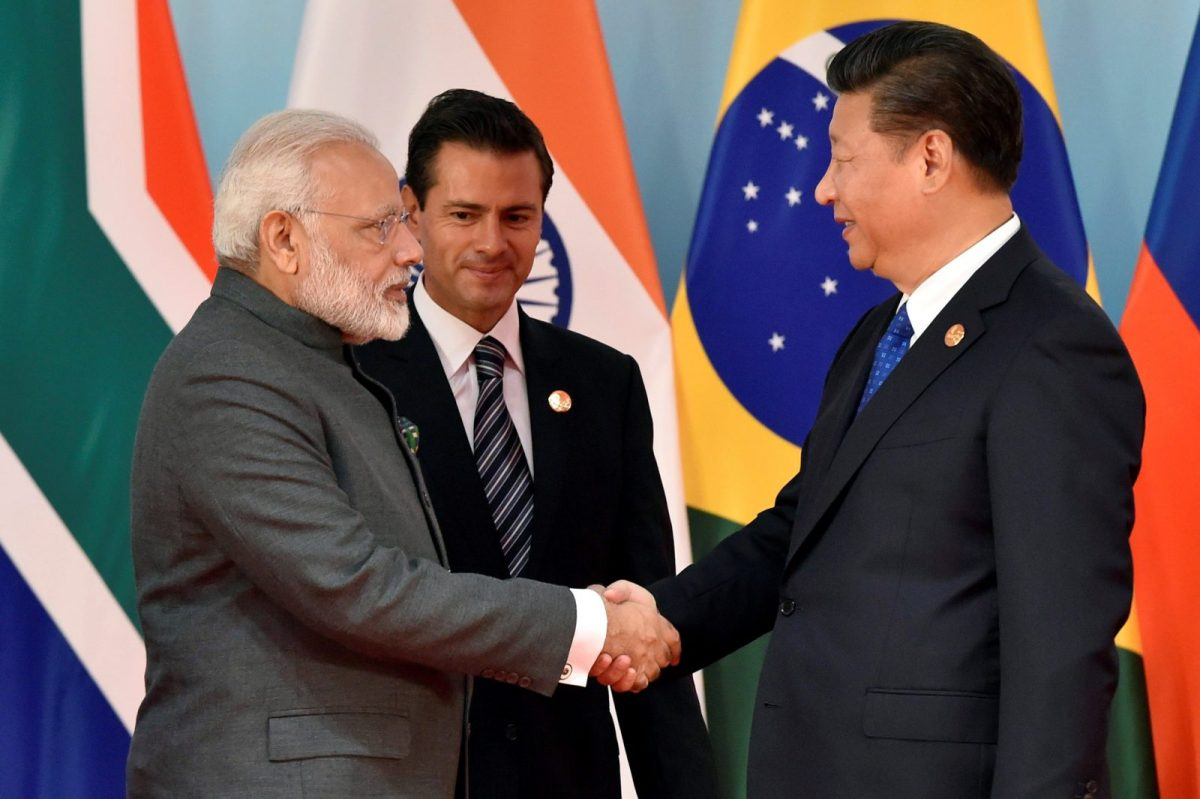 Indian Prime Minister Narendra Modi shakes hands with Chinese President Xi Jinping at the 2017 BRICS Summit in Xiamen, China, on September 5, 2017. Photo: Reuters / Kenzaburo Fukuhara / Pool