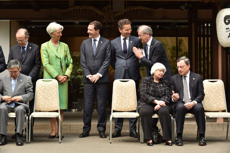 Bank of Japan Governor Haruhiko Kuroda, seated left, is seen with former Fed chair Janet Yellen and ECB President Mario Draghi, seated right, plus other central bankers and finance ministers at a G7 meeting in Japan. Photo: AFP/Kazuhiro Nogi