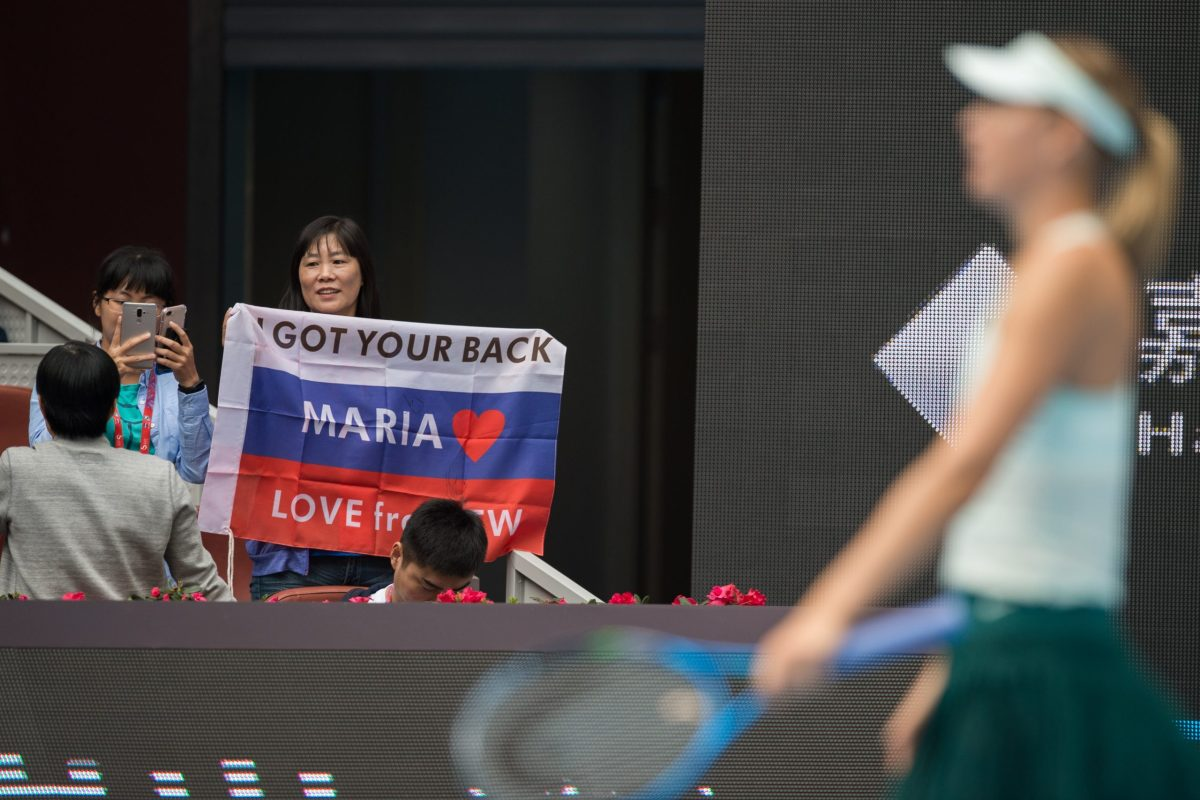 The crowd in Beijing gets behind Maria Sharapova in her match against Ekaterina Marakova on October 3, 2017. Photo: AFP / Nicolas Asfouri