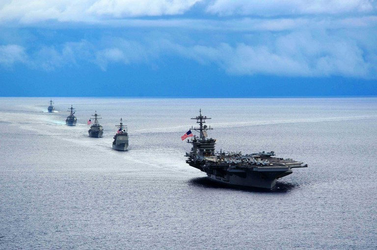 Aircraft carrier USS Theodore Roosevelt leading a formation of ships from Carrier Strike Group. Photo: AFP