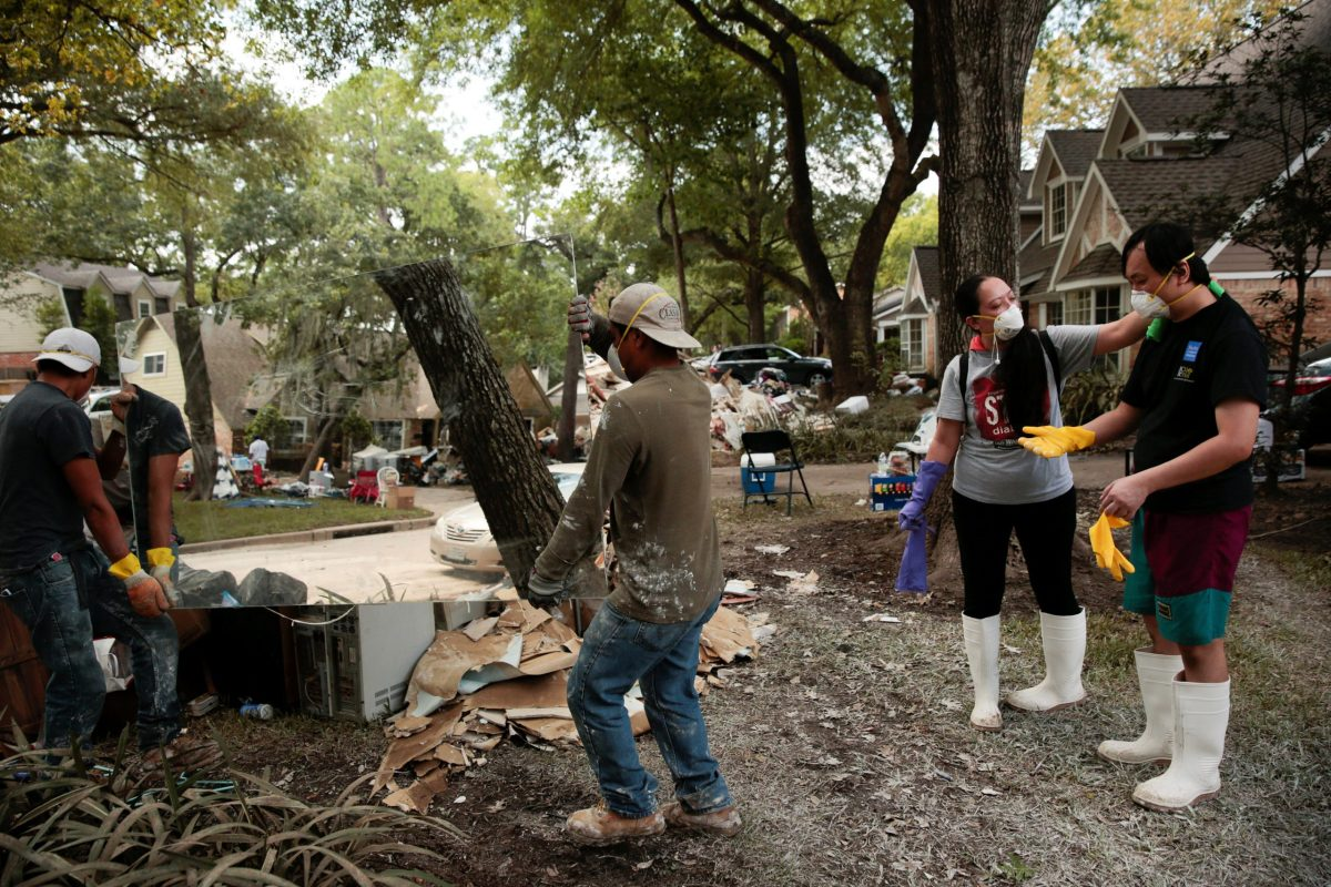 Houston residents clean up in the aftermath of tropical storm Harvey in west Houston. Photo: Reuters/Chris Aluka Berry