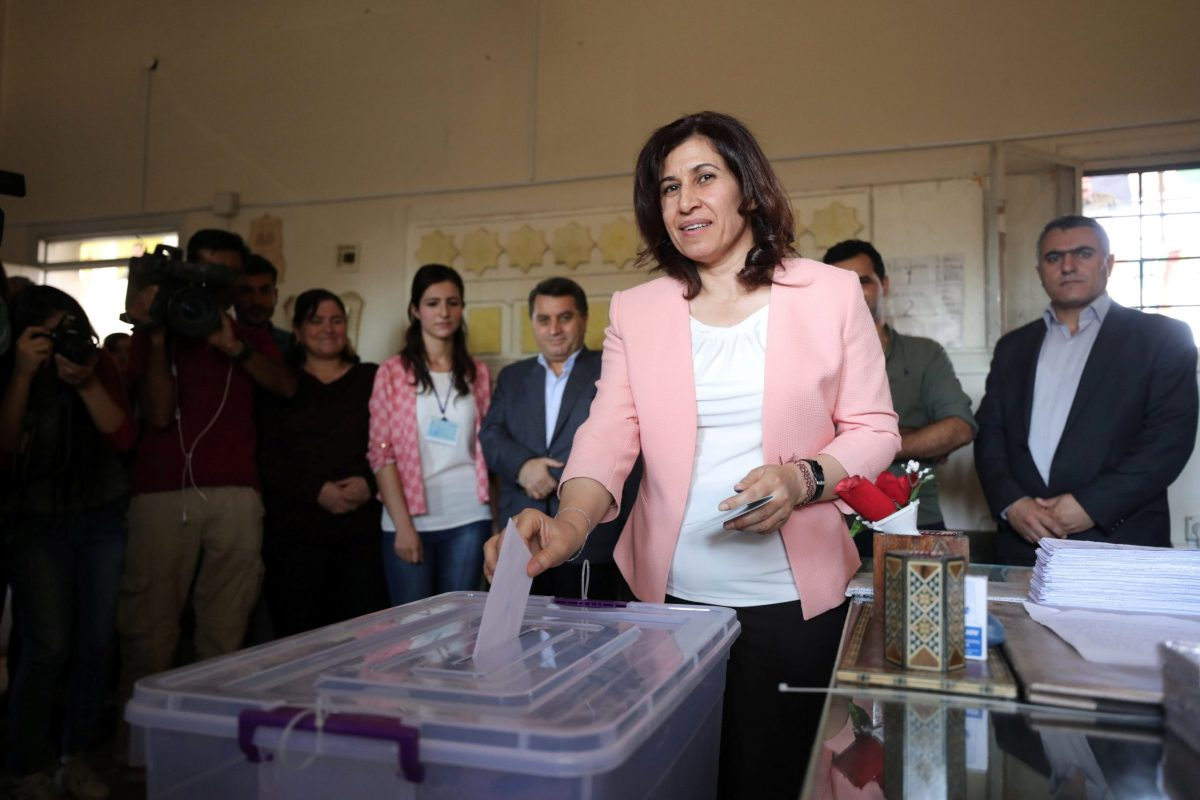 Hadiya Yousef, a Kurdish politician, casts her ballot inside a polling station in Qamishli, Syria, on September 22, 2017. Photo: Reuters / Rodi Said