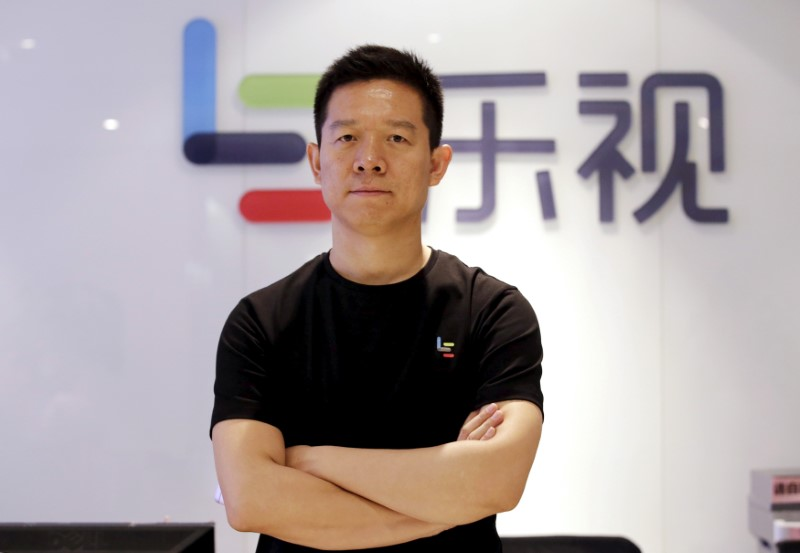 Jia Yueting, co-founder and head of Le Holdings Co Ltd, also known as LeEco and formerly as LeTV, poses for a photo in front of a logo of his company after a Reuters interview at LeEco headquarters in Beijing, China. Photo: Reuters/Jason Lee
