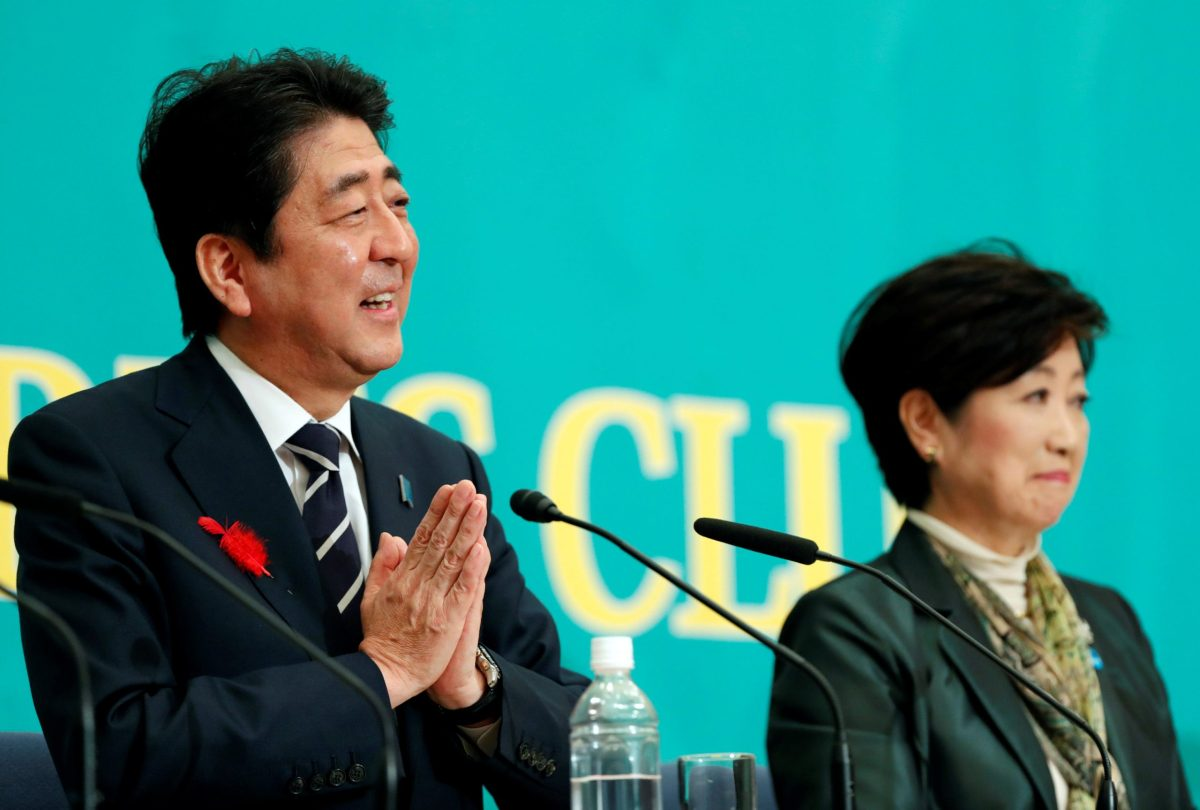 The prayers are working? Japan's Prime Minister Shinzo Abe and Yuriko Koike, his main rival in the October 22 election, attend a debate at the Japan National Press Club in Tokyo, Japan, October 8, 2017. Reuters/Kim Kyung-Hoon