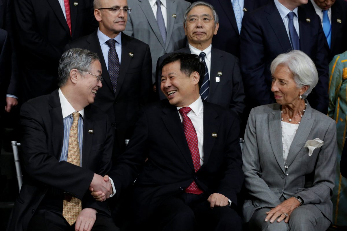 Chinese Vice Finance Minister Zhu Guangyao shakes hands with People's Bank of China Governor Zhou Xiaochuan (L) as International Monetary Fund Managing Director Christine Lagarde (R) looks on during the IMF/World Bank annual meetings in Washington on Oct 12. Photo: Reuters