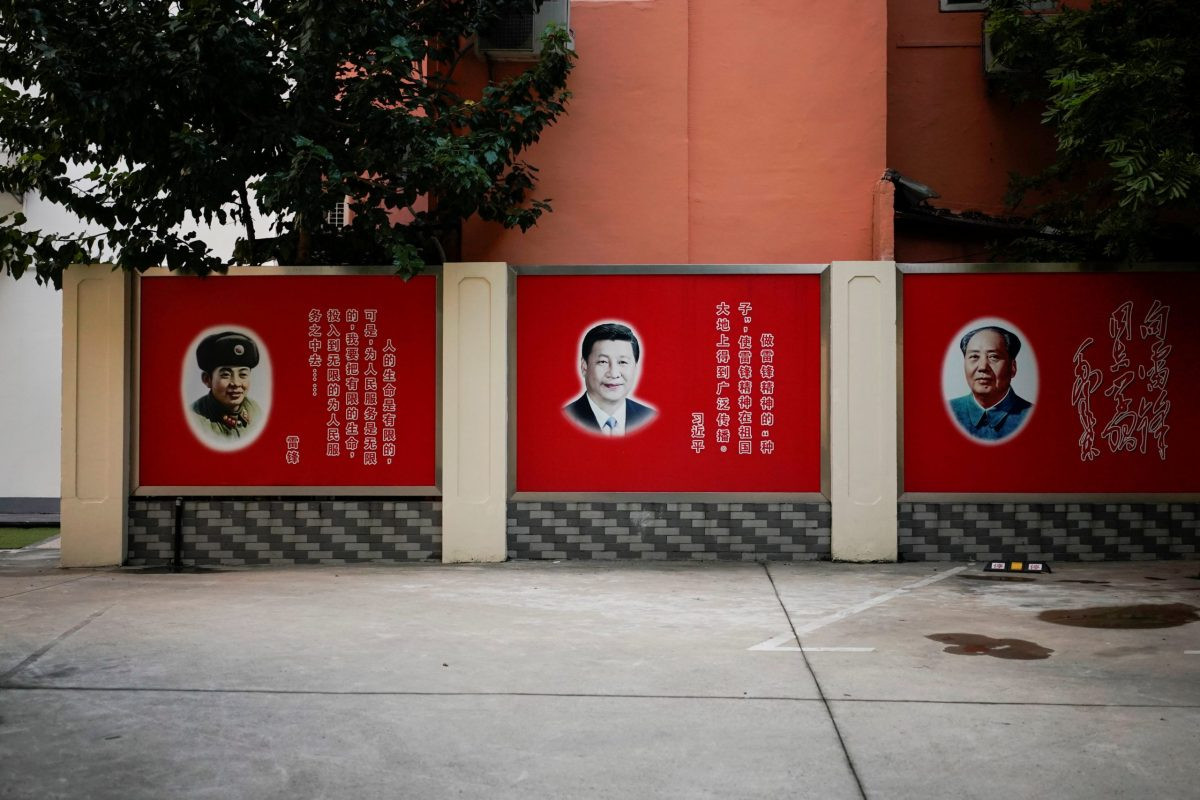 Pictures of late People's Liberation Army soldier Lei Feng, Chinese President Xi Jinping and late Chairman Mao Zedong overlook a courtyard in Shanghai. Photo: Reuters/Aly Song