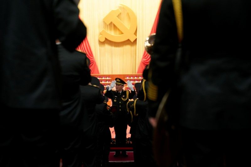 Military band members prepare inside the Great Hall of the People before the opening of the 19th National Congress of the Communist Party of China. Photo: Reuters/Aly Song