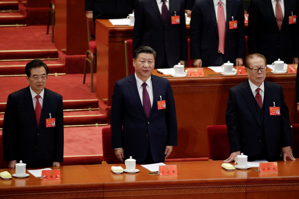 Former Chinese presidents Jiang Zemin and Hu Jintao sing the national anthem next to Xi Jinping during the opening of the 19th National Congress of the Communist Party of China at the Great Hall of the People in Beijing on October 18, 2017. Photo: Reuters / Jason Lee