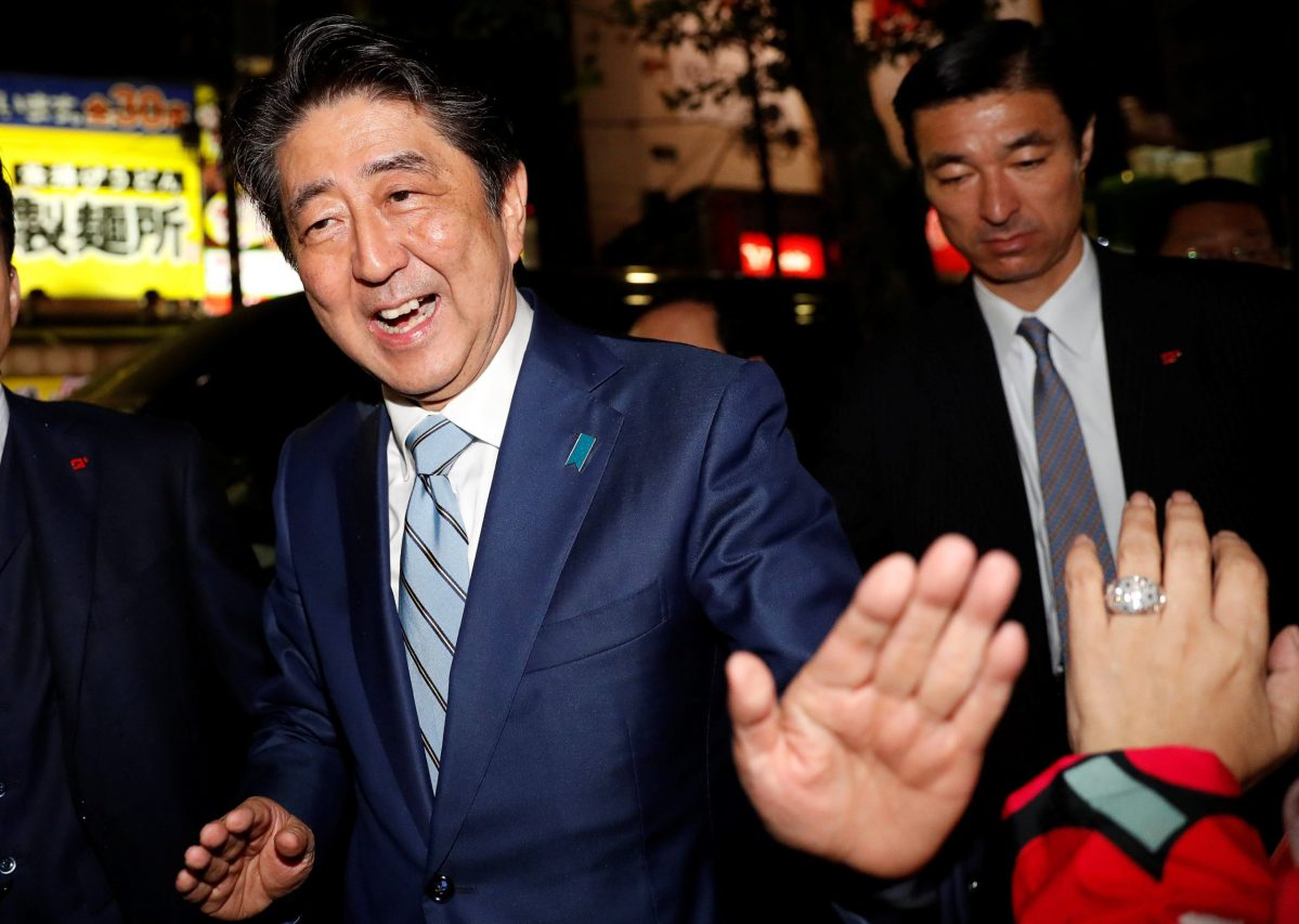 Japan's Prime Minister Shinzo Abe, leader of the Liberal Democratic Party, greets his supporters after making a speech at an election campaign rally in Tokyo, Japan October 20, 2017. REUTERS/Kim Kyung-Hoon