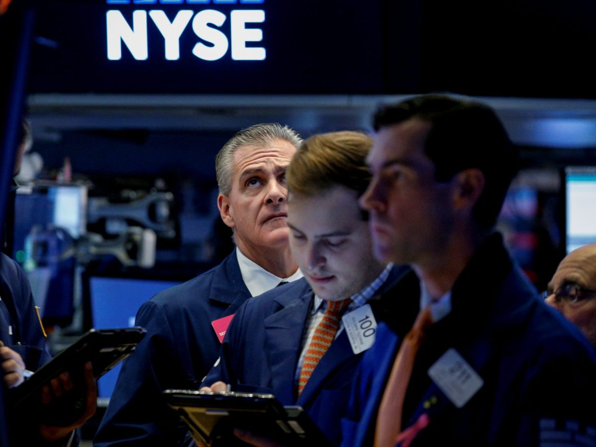 Traders work on the floor of the New York Stock Exchange (NYSE). Photo: Reuters/Brendan McDermid