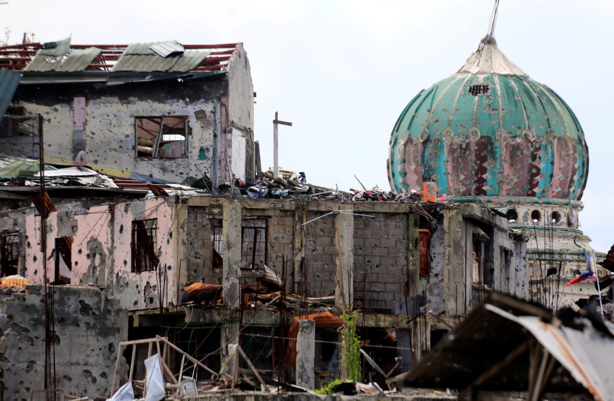 Damaged houses and buildings are seen after government troops cleared the area from pro-Islamic State militant groups inside the war-torn area in Saduc proper, Marawi city, southern Philippines October 22, 2017. REUTERS/Romeo Ranoco