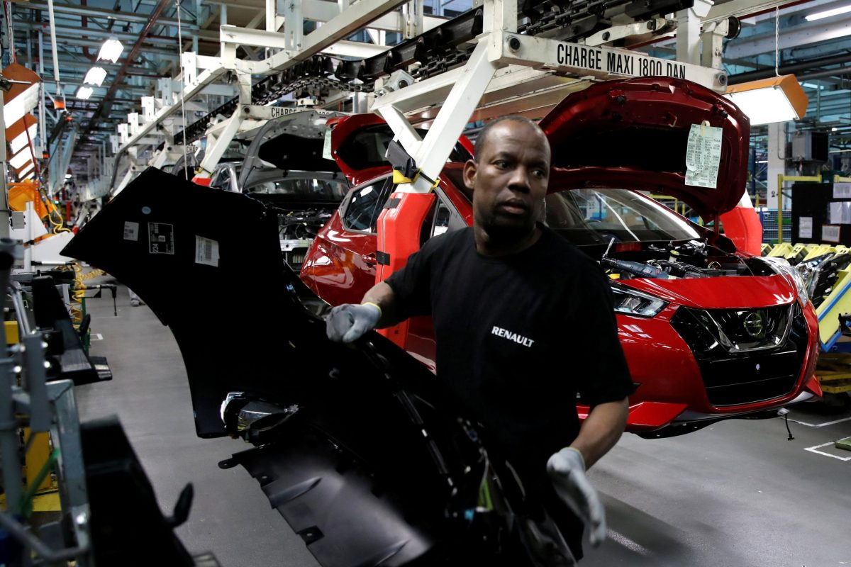 An employee works on the assembly line of the Nissan Micra at the Renault SA car factory in Flins, near Paris, France. Photo: Reuters/Benoit Tessier