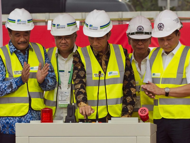 Indonesian President Joko Widodo (C), accompanied by officials, switches on a tunnel boring machine for the Mass Rapid Transport system under construction in the capital city during a launch ceremony on September 21, 2015.  Jakarta's first mass rapid transport system is expected to be finished in 2018. Photo: AFP/Romeo Gacad