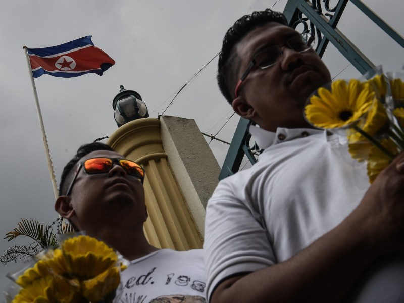 Members of a Malaysian youth group call for peace and diplomatic cooperation between Malaysia and North Korea outside the gates of the North Korean embassy in Kuala Lumpur on March 10, 2017 after the murder of Kim Jong-nam at the capital's international airport. Photo: AFP/ Suwanrumpha