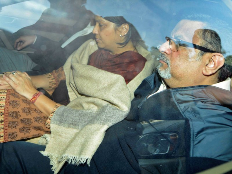 A file shot of dentists Rajesh Talwar, right, and his wife Nupur being taken to court in Ghaziabad, on the outskirts of New Delhi, in November 2013. Photo: Reuters
