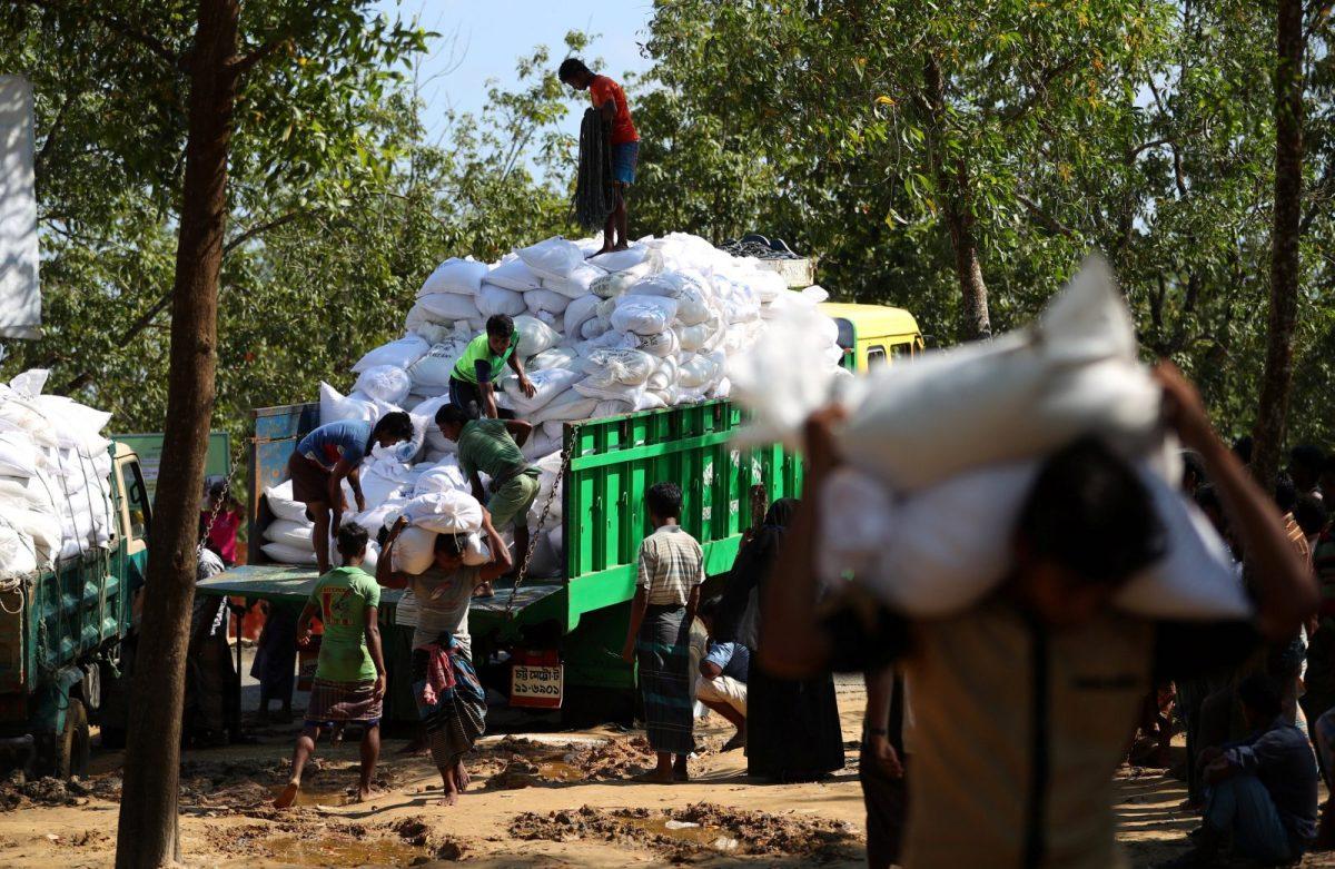 Rohingya refugees offload humanitarian aid at Kutupalong refugee camp near Cox's Bazar in Bangladesh on Monday October 23, 2017. Photo: Reuters/Hannah McKay