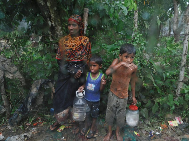 Rohingya refugees stand by the road in the rain outside their camp near Cox's Bazar, Bangladesh, October 3, 2017. REUTERS/Damir Sagolj