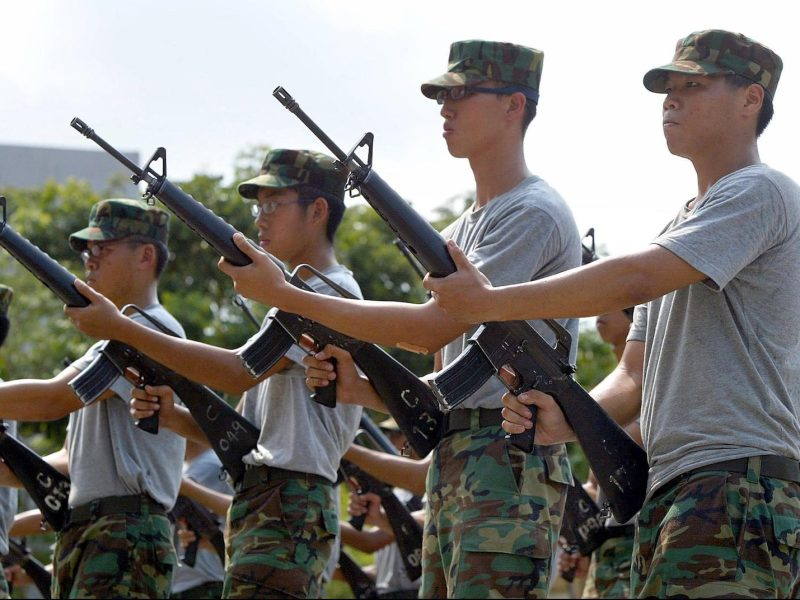 Recruits goes through arms drills at Pulau Tekong, a military training island in Singapore. All able-bodied young men in Singapore, including citizens and permanent residents, are conscripted for two years of full-time military training once they reach 18 under the National Service program founded in 1967 to promote national cohesion.  Photo: AFP/Roslan Rahman