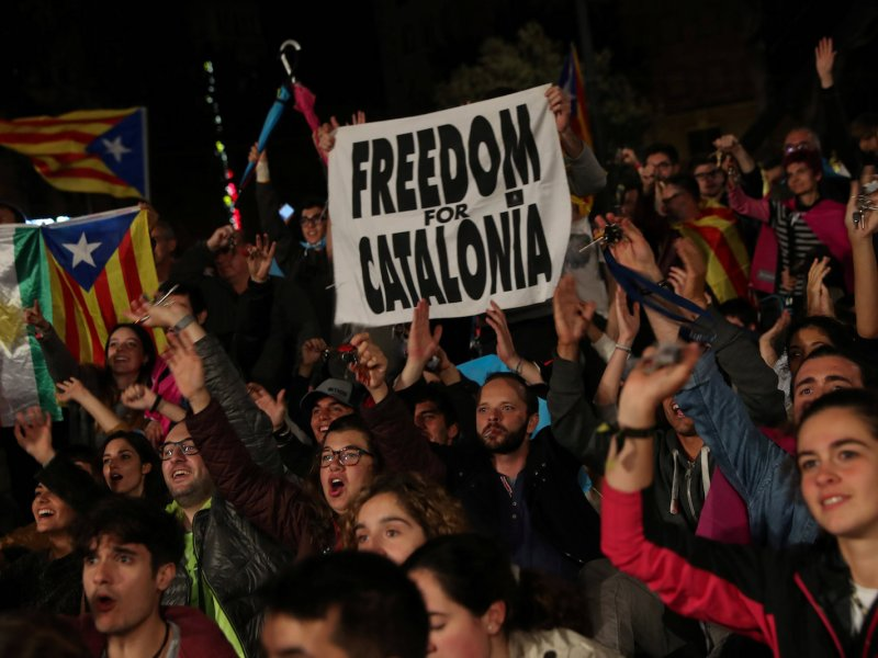People react as they gather at Plaza Catalunya after voting ended for the banned independence referendum, in Barcelona, Spain October 1, 2017. Photo: Reuters/Susana Vera