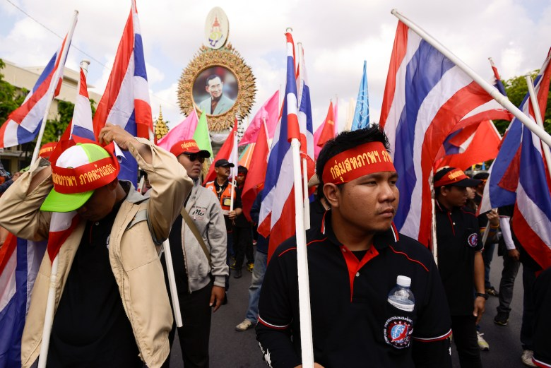 Thai worker hold up flag during parade to celebrate for Labour Day in on 1st May 2017 in Bangkok, Thailand. (Photo by Anusak Laowilas/NurPhoto)