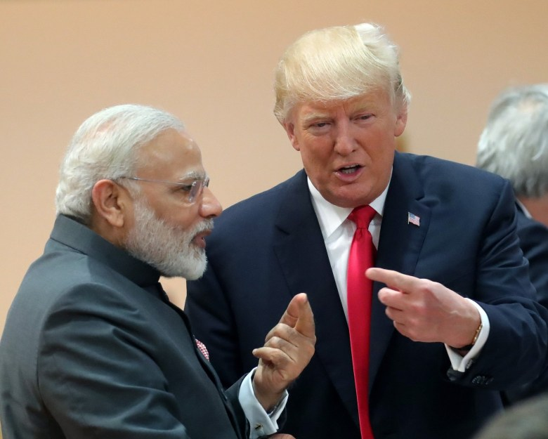 Rock, paper, scissors. Indian Prime Minister Narendra Modi is pictured with US President Donald Trump at the G20 Summit in Hamburg, Germany, in July 2017. Photo: dpa