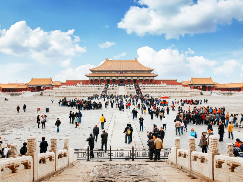 Lots of tourists meeting in front of the entrance to the forbidden city in Beijing, China. Photo: iStock