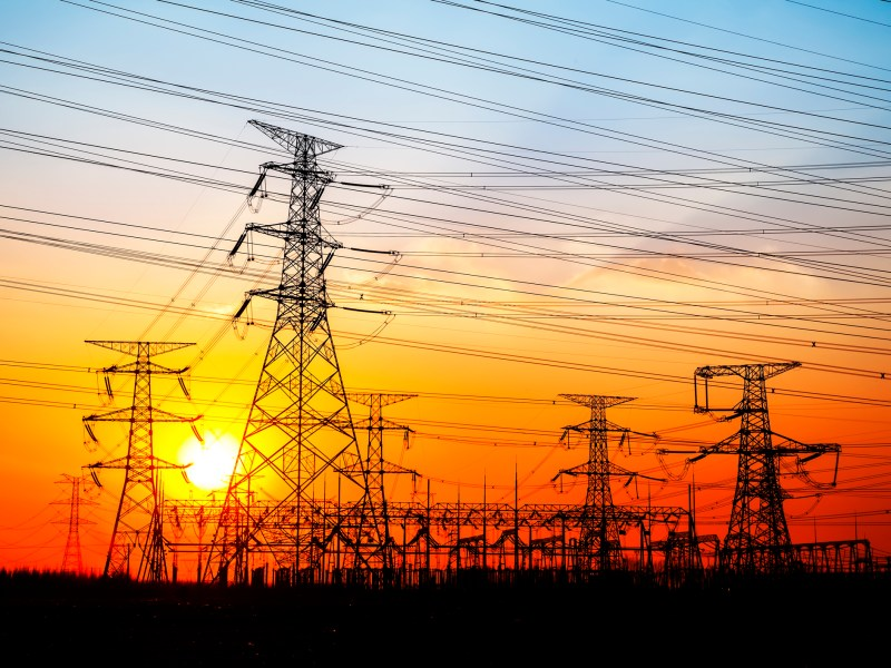 The silhouette of the evening electricity transmission pylon. Photo: iStock