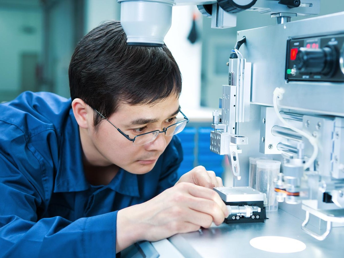 An electronics engineer works on semiconductor test equipment. Photo: iStock