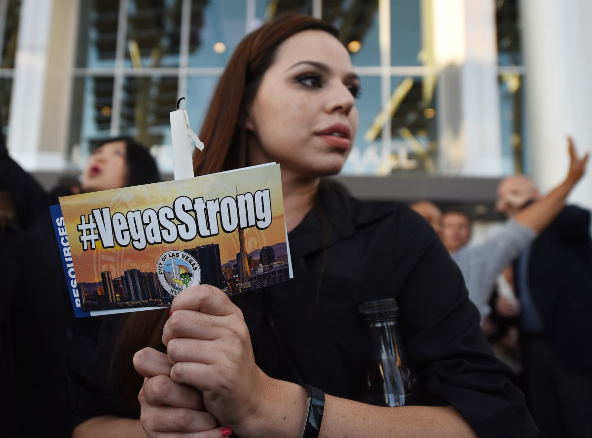 A candlelight vigil is held at Las Vegas city hall following the mass shooting during a country-music concert in September. Photo: AFP / Robyn Beck