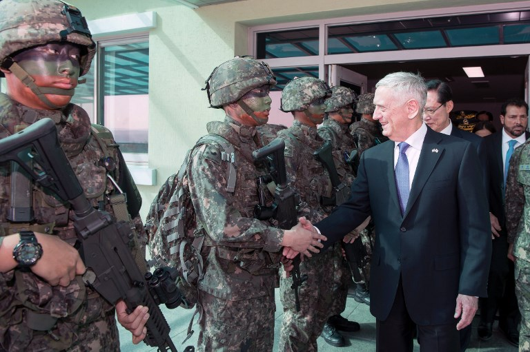 US Defense Secretary Jim Mattis and former South Korean defense minister Song Young-moo greet troops at the Demilitarized Zone between North and South Korea in this recent file shot. Photo: US Dept of Defense via AFP