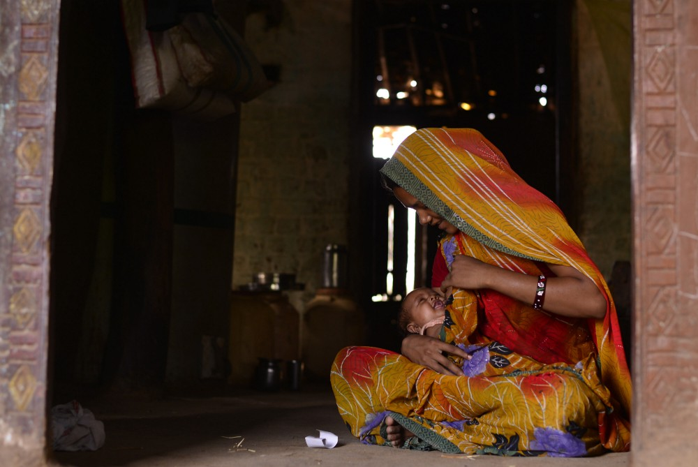 A woman breastfeeding her child in Indore. Photo: Rohit Jain