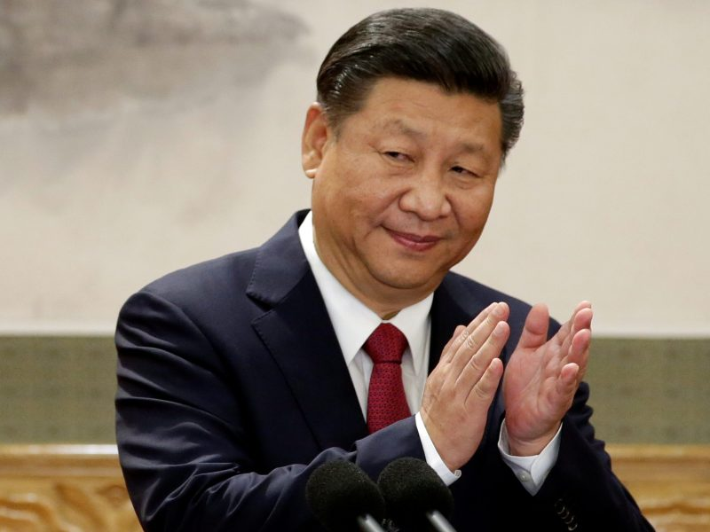 China's President Xi Jinping claps after his speech as he and other new Politburo Standing Committee members meet with the press at the Great Hall of the People in Beijing, China October 25, 2017. REUTERS/Jason Lee