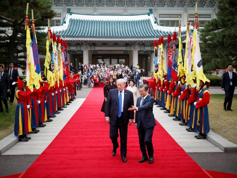 US President Donald Trump walks with South Korea's President Moon Jae-in during a welcoming ceremony at the Presidential Blue House in Seoul. Photo: Reuters/Kim Hong-Ji