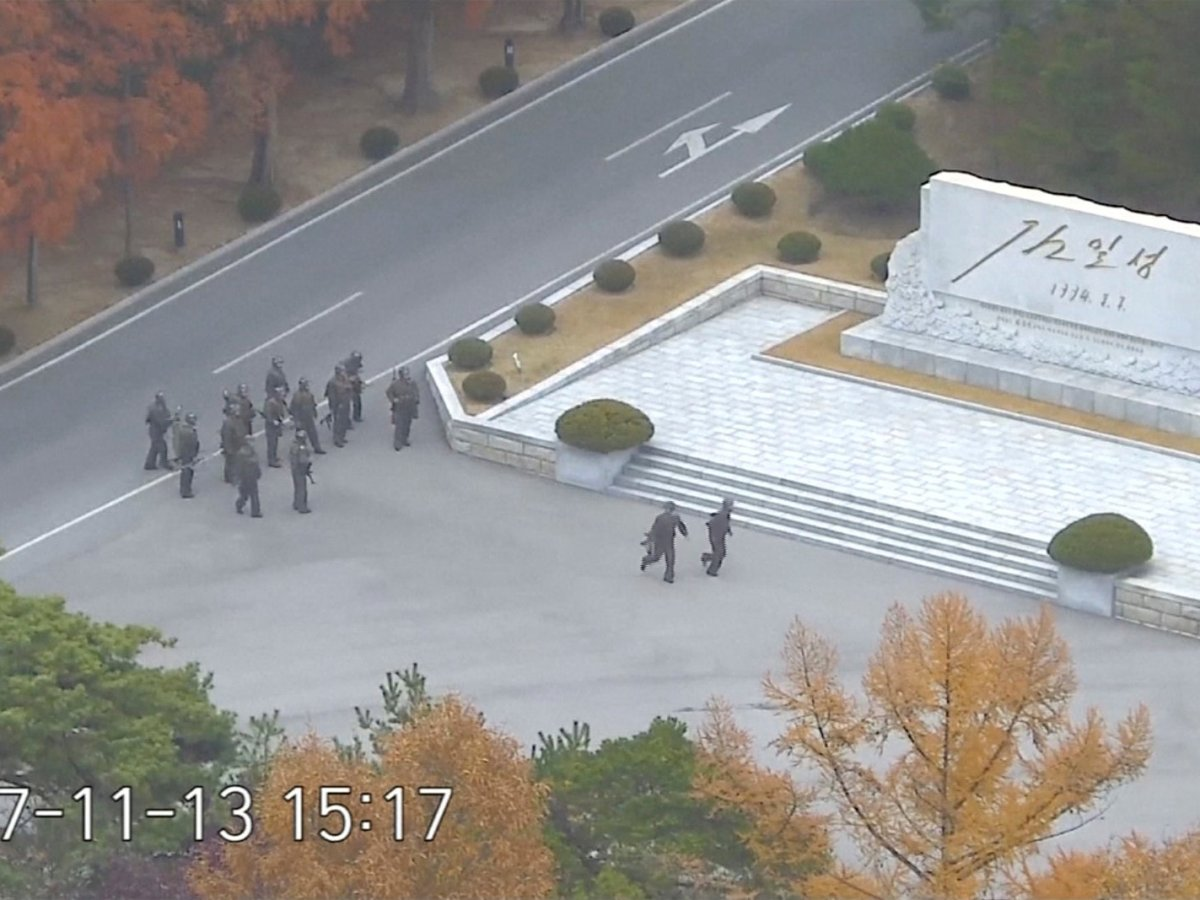 North Korean soldiers hold rifles and gather in the North Korean side of the Joint Security Area at the Demilitarized Zone between North and South Korea. United Nations Command/Handout via Reuters