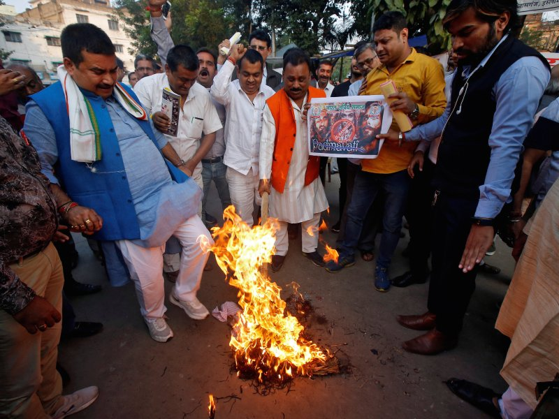 "Demonstrators burn an effigy depicting film director Sanjay Leela Bhansali during a protest, organized by members of Bharat Kshatriya Samaj, against the release of Bollywood movie ""Padmavati"" in Kolkata, India, November 22, 2017. Photo: Reuters Rupak De Chowdhuri    NO RESALES. NO ARCHIVES"