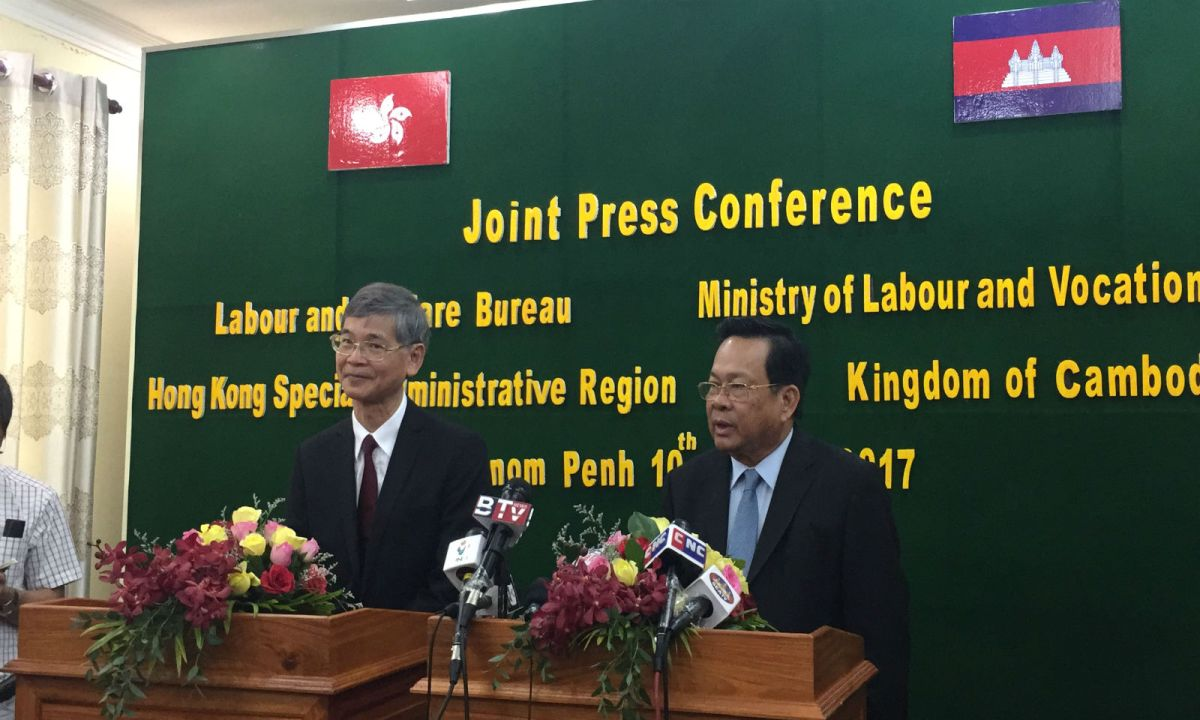 Secretary for Labour and Welfare Dr Law Chi-kwong, left, is seen with Cambodia's Minister of Labour and Vocational Training Dr Ith Samheng in a meeting last month on enabling Cambodians to work as domestic helpers in Hong Kong. Photo: HK Government