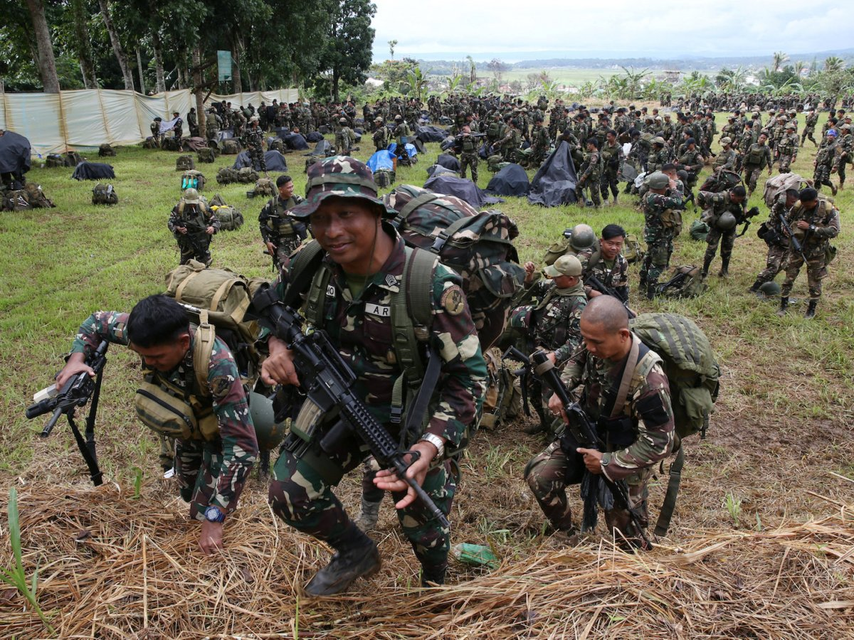 Philippine troops during a send-off ceremony ending their combat duty against pro-Islamic State militant groups inside military headquarters in Marawi city, October 25, 2017.    Photo: Reuters/Romeo Ranoco