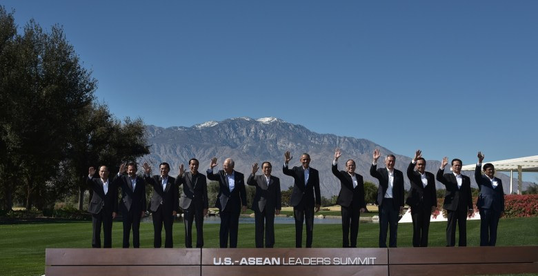 US President Barack Obama and leaders take part in a group photo during a meeting of the Association of Southeast Asian Nations (ASEAN) at the Sunnylands estate on February 16, 2016 in Rancho Mirage, California. From left: ASEAN Secretary General  Le Luong Minh, Brunei's Sultan Hassanal Bolkiah, Cambodia's Prime Minister Hun Sen, Indonesia's President Joko Widodo, Malaysia's Prime Minister Najib Razak, Laos' President Choummaly Sayasone, Obama, Philippine's President Benigno Aquino, Singapore's Prime Minister Lee Hsien Loong, Thailand's Prime Minister Prayut Chan-O-Cha, Vietnam's Prime Minister Nguyen Tan Dung, and Myanmar's Vice President Nyan Tun. / AFP PHOTO / MANDEL NGAN