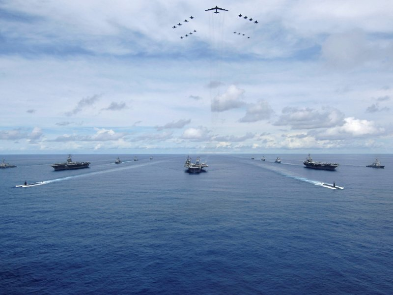 The USS Nimitz, USS Kitty Hawk and USS John C. Stennis Carrier Strike Groups transit in formation during a joint exercise in the Pacific Ocean. Photo: US Navy via Reuters / Stephen W. Rowe