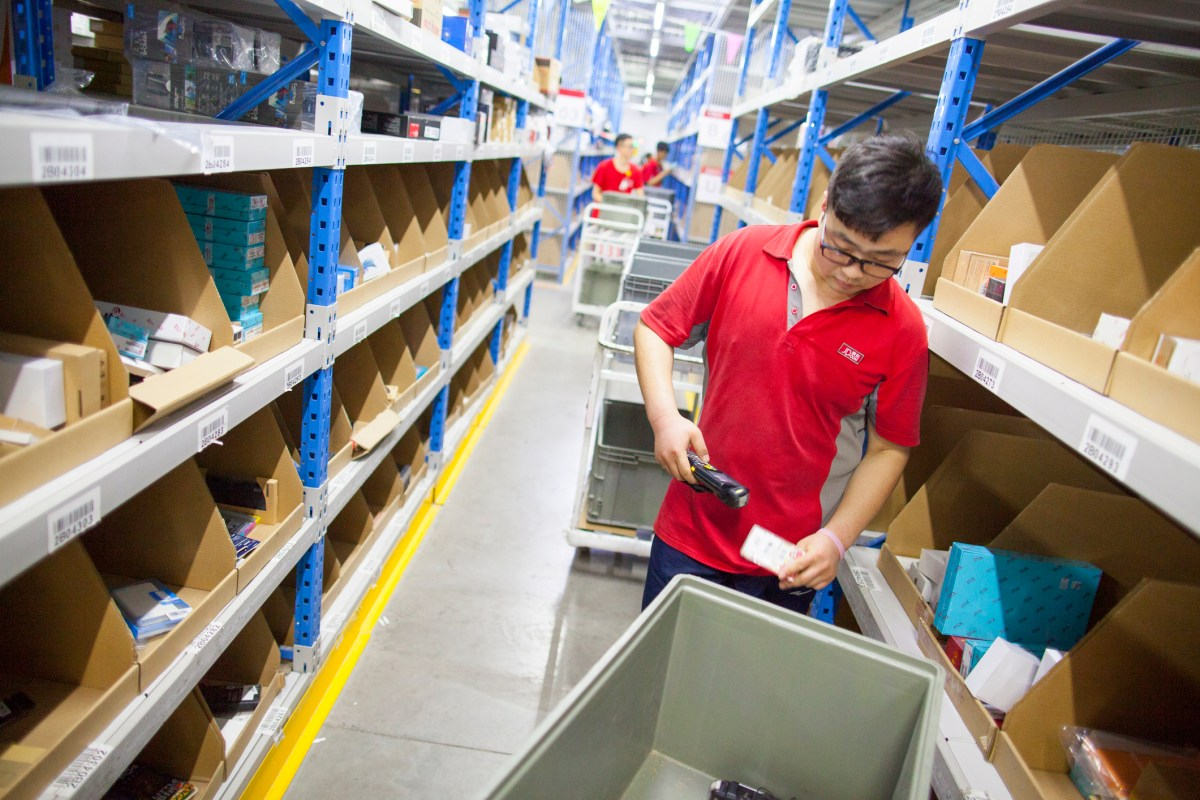 Staff of an E-commerce site JD.com sorting out products in the warehouse. Photo: iStock